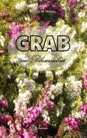 Grab im Blumenbeet